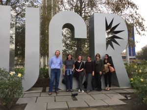 """group photo in front of Large sculpture letters """"UCR"""""""